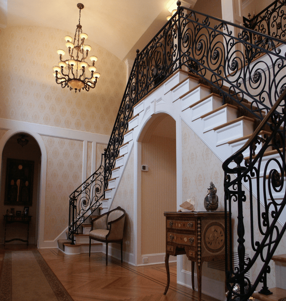 Showcasing stairs and chandelier